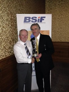 Alan Murray CEO of BSIF presenting The McOnie Agency sponsored award to John Cairns, Chairman of Safety Groups UK